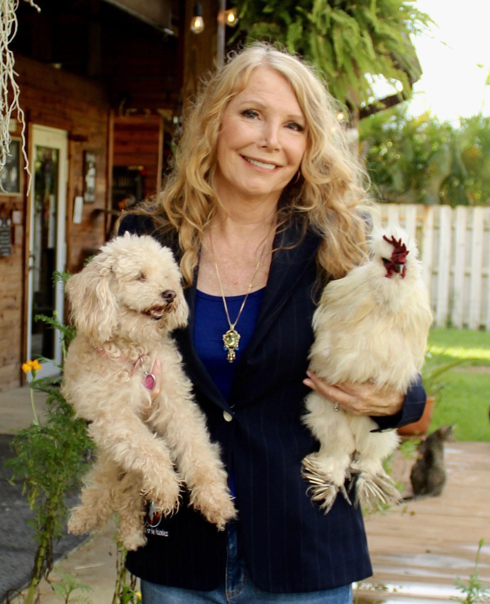 Image of Susan Hargreaves with her dog and a chicken