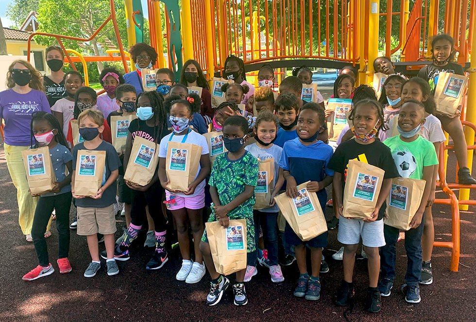 Image of Kids in Distress school students enjoyed veggie burgers and Animal Hero Kids pledge cards