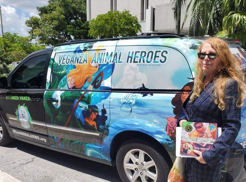 Image of Susan Hargreaves with Animal Hero Kids Veganza car - left side view of artwork
